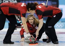 Canada's skip Jennifer Jones delivers the stone during women's curling competition against South Korea at the 2014 Winter Olympics, Monday, Feb. 17, 2014, in Sochi, Russia. (AP Photo/Robert F. Bukaty)