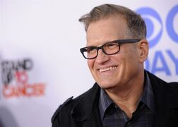 FILE - In this Oct. 8, 2013 file photo, Drew Carey arrives at the CBS Daytime After Dark comedy event at The Comedy Store in West Hollywood, Calif. Singer John Mayer, filmmaker Judd Apatow and comic Carey will be among the guest hosts that will fill in on CBS'