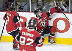Quebec Remparts captain Mikael Tam, right, celebrates his goal against Halifax Mooseheads during first period QMJHL playoff action Tuesday, April 17, 2012 at the Colisee in Quebec City. Quebecor Inc. has become the new owner of the Quebec Remparts. THE CANADIAN PRESS/Jacques Boissinot