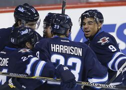 Winnipeg Jets' Evander Kane (9), Grant Clitsome (24), Jay Harrison (23), Matt Halischuk (15) and Adam Lowry (17) celebrate Kane's goal on the Boston Bruins during first period NHL action in Winnipeg on Friday.