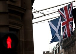 A Saltire and Union Jack flag hang side by side on a building in Edinburgh, Scotland, Friday, Sept. 19, 2014. THE CANADIAN PRESS/AP, Scott Heppell
