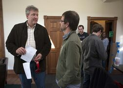 "In this photo provided by Point Park University, producer Chris Moore, left, talks with Point Park University Cinema Arts Associate Professor Nelson Chipman, on the set of Anna Martemucci's film, ""Hollidaysburg,""in Carnegie, Pa. on March 15, 2014. Television network Starz debuts a TV reality series"