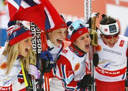 Norway's Heidi Weng,Therese Johaug, Astrid Jacobsen and Marit Bjoergen celebrate after winning the women's 4x5 km relay at the Nordic Skiing World Championships in Falun, Sweden, Thursday, Feb. 26, 2015. (AP Photo/Matthias Schrader)