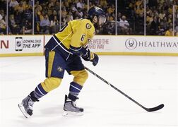 Nashville Predators defenseman Shea Weber leaves the ice after being injured during the second period of Game 2 of an NHL hockey first-round playoff series against the Chicago Blackhawks Friday, April 17, 2015, in Nashville, Tenn. Weber did not return to the game. (AP Photo/Mark Humphrey)