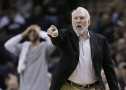 San Antonio Spurs head coach Gregg Popovich argues a call during the first half of an NBA basketball game against the Sacramento Kings, Wednesday, March 4, 2015, in San Antonio. (AP Photo/Eric Gay)