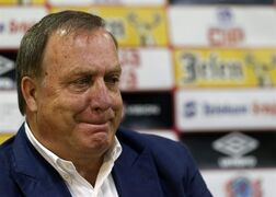 Newly-appointed Serbian national soccer team coach Dick Advocaat listens during a press conference in Stara Pazova, Serbia, Monday, July 28, 2014. Advocaat signed a two-year contract with Serbia and has the mandate to lead them to the 2016 European Championship in France. (AP Photo/Darko Vojinovic)