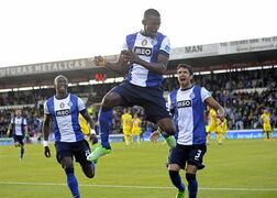 FC Porto's Jackson Martinez, center, from Colombia, celebrates with Lucho Gonzalez, from Argentina, and Eliaquim Mangala, left, from France, after scoring his team second goal against Pacos Ferreira in the last match of the Portuguese League soccer season at Mata Real stadium in Pacos de Ferreira, Portugal, Sunday, May 19, 2013. (AP Photo/Paulo Duarte)