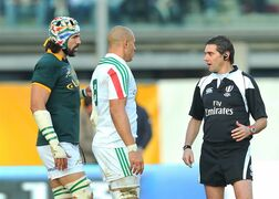 Referee Jerome Garces, right, talks Italy's Sergio Parisse, right, and South Africa's Victor Matfield, during an international rugby union test match between Italy and South Africa, in Padua, Italy, Saturday, Nov. 22, 2014. South Africa remained unbeaten against Italy in toughing out a 22-6 win at Stadio Euganeo on Saturday. South Africa spent most of the match camped in Italy's half, but Italy scrambled in defense superbly - 128 tackles to South Africa's 53 - and leaned on its rock-solid scrum to limit the Springboks to three tries. (AP Photo/Paolo Giovannini)