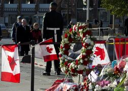 Governor General David Johnston and his wife Sharon pay their respects at the National War Memorial shortly after the honour guard take their posts Thursday October 30, 2014 in Ottawa. THE CANADIAN PRESS/Adrian Wyld