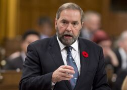 NDP leader Tom Mulcair rises during question period in the House of Commons Thursday, October 30, 2014 in Ottawa. THE CANADIAN PRESS/Adrian Wyld