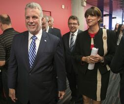 Quebec Premier Philippe Couillard, left, and Gaz Metro chief executive Sophie Brochu arrive at a news conference Tuesday, September 30, 2014 in Montreal. Gaz Metro and the Quebec government announced a partnership to increase the natural gas liquefaction capacity at the Gaz Metro plant in eastern Montreal. THE CANADIAN PRESS/Ryan Remiorz