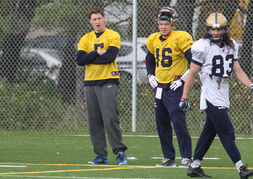 Winnipeg Blue Bombers Drew Willy (5) watches practice from the sideline with Robert Marve (16) at Bison Field Sunday afternoon.