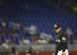 Miami Marlins starter Henderson Alvarez checks a Philadelphia Phillies runner on first base during the first inning of a baseball game in Miami, Tuesday, Sept. 23, 2014. (AP Photo/J Pat Carter)