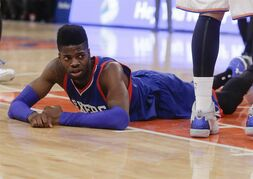 Philadelphia 76ers' Nerlens Noel reacts after being fouled by New York Knicks' Quincy Acy during the first half of an NBA basketball game Saturday, Nov. 22, 2014, in New York. (AP Photo/Frank Franklin II)