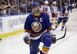 New York Islanders' John Tavares reacts after scoring the winning goal during the overtime period of Game 3 of a first-round NHL hockey playoff series against the Washington Capitals Sunday, April 19, 2015, in Uniondale, N.Y. The Islanders defeated the Capitals 2-1. (AP Photo/Seth Wenig)