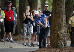 Troy Merritt hits from the cart path on the 15th fairway during the second round of the RBC Heritage golf tournament in Hilton Head Island, S.C., Friday, April 17, 2015. (AP Photo/Stephen B. Morton)
