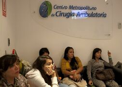 In this Sept, 4, 2014 photo, breast implant patients sit in a waiting room at the metropolitan outpatient surgery center in Caracas, Venezuela. Doctors say restrictive currency controls that deprive local businesses of the cash to import foreign goods have caused implants approved by the U.S. Food and Drug Administration to disappear. Beauty-obsessed Venezuelans face a scarcity of brand-name breast implants, and women are so desperate that they and their doctors are turning to devices that are the wrong size or made in China, with less rigorous quality standards. (AP Photo/Ariana Cubillos)
