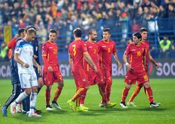 Montenegro's players leave the pitch after Russian goalkeeper Igor Akinfeev was hit by a flare thrown from the stands during the Euro 2016 Group G qualifying soccer match between Montenegro and Russia, at the City Stadium in Podgorica, Montenegro, Friday, March 27, 2015. (AP Photo/Risto Bozovic)