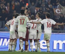 Referee Nicola Rizzoli gives a red card to AC Milan's Pablo Armero during an Italian Serie A soccer match between Roma and AC Milan at Rome's Olympic stadium, Saturday, Dec. 20, 2014. (AP Photo/Alessandra Tarantino)