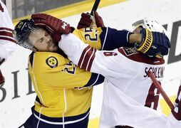 Nashville Predators left wing Viktor Stalberg (25), of Sweden, and Arizona Coyotes defenceman David Schlemko (6) scuffle in the second period of an NHL hockey game Tuesday, Oct. 21, 2014, in Nashville, Tenn. The Predators have placed forward Viktor Stalberg on waivers, so they can assign him to the Milwaukee Admirals of the American Hockey League for conditioning coming off an injured knee. THE CANADIAN PRESS/ AP/Mark Humphre