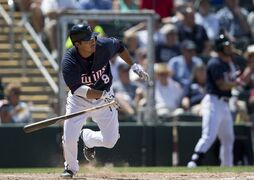 Minnesota Twins catcher Kurt Suzuki drops the bat after hitting and getting out in the fifth inning during an exhibition spring training baseball game, Wednesday against the Boston Red Sox, April 1, 2015, in Fort Myers, Fla. (AP Photo/Brynn Anderson)