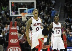 Atlanta Hawks guard Jeff Teague (0) reacts after making a go-ahead jumper late in an NBA basketball game against the Houston Rockets, Tuesday, March 3, 2015, in Atlanta. Atlanta won 104-96. (AP Photo/John Amis)