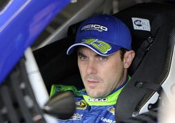 Driver Casey Mears waits to practice for Sunday's NASCAR Sprint Cup Series auto race Saturday, Feb. 28, 2015, in Hampton, Ga. (AP Photo/John Amis)