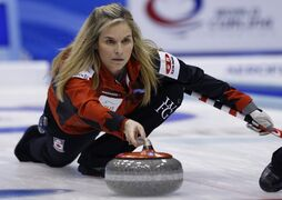 Canada's Jennifer Jones delivers a stone as the team plays Switzerland during the second end of final of the women's World Curling Championships in Sapporo, northern Japan, Sunday, March 22, 2015.