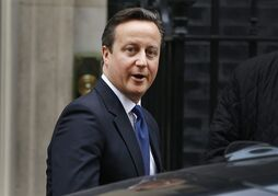 Britain's Prime Minister David Cameron leaves Downing Street to attend the weekly session of Prime Ministers Questions in parliament in London, Wednesday, Jan. 21, 2015. (AP Photo/Kirsty Wigglesworth)