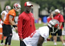 FILE - In this April 22, 2014, file photo, Tampa Bay Buccaneers head coach Lovie Smith, center, watches during NFL minicamp football in Tampa, Fla. (AP Photo/Chris O'Meara, File)