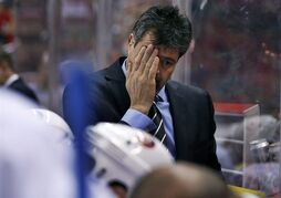 New York Islanders head coach Jack Capuano rubs his face in the second period of an NHL hockey game against the Washington Capitals, Friday, Nov. 28, 2014, in Washington. The Capitals won 5-2. (AP Photo/Alex Brandon)
