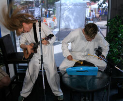 Ingrid Hansen (left) and Rod Peter Jr. rock out on the ukulele and glockenspiel performing their Fringe show Kitt & Jane: An Interactive Survival Guide to the Near-Post-Apocalyptic Future at the News Café Friday afternoon.