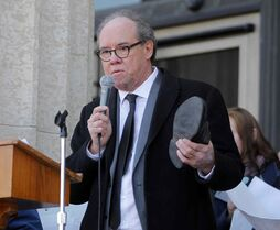 Manitoba Finance Minister Greg Dewar, shown here addressing a rally by anti-poverty advocates at the provincial Legislative Building on Thursday.