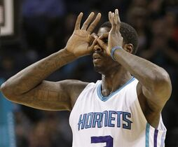 Charlotte Hornets' Marvin Williams gestures after making a 3-point basket against the Phoenix Suns during the first half of an NBA basketball game in Charlotte, N.C., Wednesday, Dec. 17, 2014. (AP Photo/Chuck Burton)