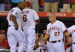 Los Angeles Angels' Mike Trout, right, congratulates David Freese, center, as Howie Kendrick looks on after Freese hit a three-run home run during the fifth inning of a baseball game against the Texas Rangers, Saturday, Sept. 20, 2014, in Anaheim, Calif. (AP Photo/Mark J. Terrill)