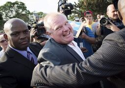 Mayor Rob Ford is escorted by security through a party thrown by his family called Ford Fest in Toronto on Friday, July 25, 2014. THE CANADIAN PRESS/Darren Calabrese