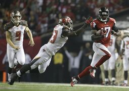 Tampa Bay Buccaneers running back Bobby Rainey (43) defends against Atlanta Falcons wide receiver Devin Hester (17) during the second half of an NFL football game, Thursday, Sept. 18, 2014, in Atlanta. (AP Photo/David Goldman)