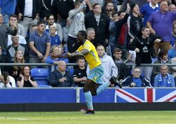 Crystal Palace's Yannick Bolasie celebrates scoring his side's second goal of the game during their English Premier League soccer match against Everton at Goodison Park, Liverpool, England, Sunday, Sept. 21, 2014. (AP Photo/Peter Byrne, PA Wire) UNITED KINGDOM OUT - NO SALES - NO ARCHIVES