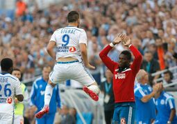 Marseille's French forward Andre-Pierre Gignac, left, reacts with Marseille's Congolese goalkeeper Brice Samba, after scoring against Rennes, during their League One soccer match, at the Velodrome Stadium, in Marseille, southern France, Saturday, Sept. 20, 2014. (AP Photo/Claude Paris)