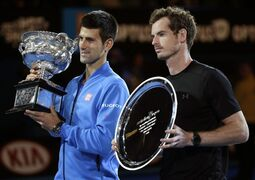 Novak Djokovic of Serbia, left, holds the trophy with runner-up Andy Murray of Britain during the trophy presentation after winning their men's singles final at the Australian Open tennis championship in Melbourne, Australia, Sunday, Feb. 1, 2015. (AP Photo/Vincent Thian)