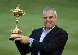 Europe team captain Paul McGinley holds up the trophy after winning the 2014 Ryder Cup golf tournament at Gleneagles, Scotland, Sunday, Sept. 28, 2014. (AP Photo/Peter Morrison)