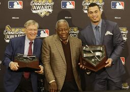 Major League Baseball Commissioner Bud Selig, left, poses with Hank Aaron and the winner of the 2014 Hank Aaron Award Giancarlo Stanton of the Miami Marlins before Game 4 of baseball's World Series Saturday, Oct. 25, 2014, in San Francisco. (AP Photo/Jeff Chiu)