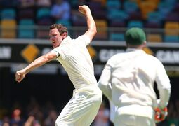 Australia's Josh Hazelwood, left, celebrates after taking the wicket of India's Cheteshwar Pujara during the second cricket test match in Brisbane, Australia, Wednesday, December 17, 2014. (AP Photo/Tertius Pickard)