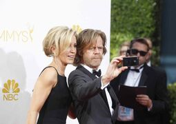William H. Macy and wife Felicity Huffman arrive for the 66th Annual Primetime Emmy Awards at Nokia Theatre at L.A. Live in Los Angeles.