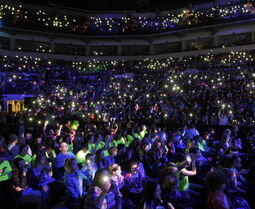 About 16,000 students attending the We Day event Wednesday light up the their cell phones at the MTS Centre.