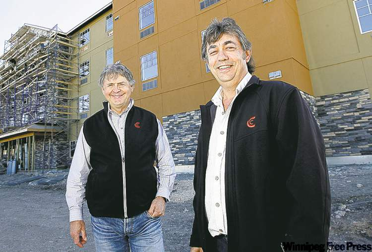 John Owens (left) and Fred Hrehirchuk are optimistic the upcoming extended-stay MainStay Suites Hotel will be popular.
