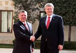 Jordan's King Abdullah II, left, shakes hands with Canadian Prime Minister Stephen Harper at the royal palace in Amman, Jordan Thursday, Jan. 23, 2014. A Jordanian newspaper is reporting that Prime Minister Stephen Harper will host King Abdullah II, one of his key allies in the fight on terrorism, in Ottawa in the coming days. THE CANADIAN PRESS/AP/Raad Adayleh