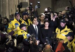 Jian Ghomeshi makes his way through a mob of media with his lawyer Marie Henein at a Toronto court Wednesday, November 26, 2014. A damning report detailing CBC management missteps in stopping alleged inappropriate behaviour by former radio host Jian Ghomeshi reinforces the need for safe work environments and mechanisms in place for employees to freely voice concerns, experts say. THE CANADIAN PRESS/Darren Calabrese