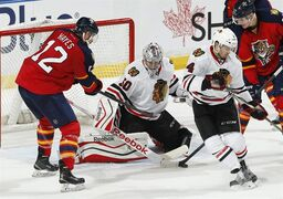 Chicago Blackhawks goaltender Corey Crawford (50) stops a shot by Florida Panthers forward Jimmy Hayes (12) during the third period of an NHL hockey game, Thursday, Feb. 26, 2015, in Sunrise, Fla. The Blackhawks defeated the Panthers 3-0. (AP Photo/Joel Auerbach)