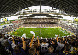 The crowd at the inaugural regular-season game at Investors Group Field in Winnipeg on June 27, 2013.